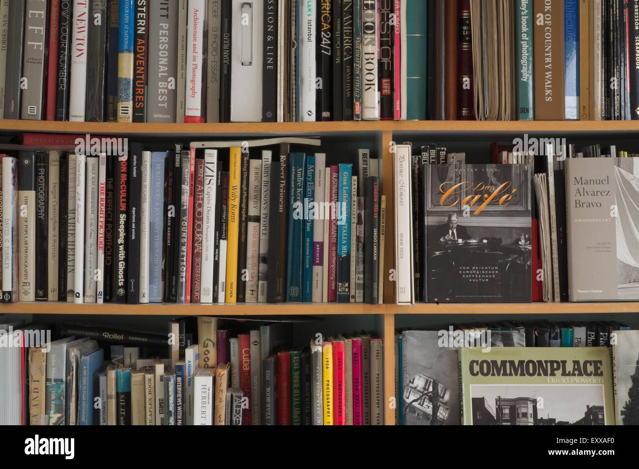 Bookshelf With Photography Books In Home Of Photographer