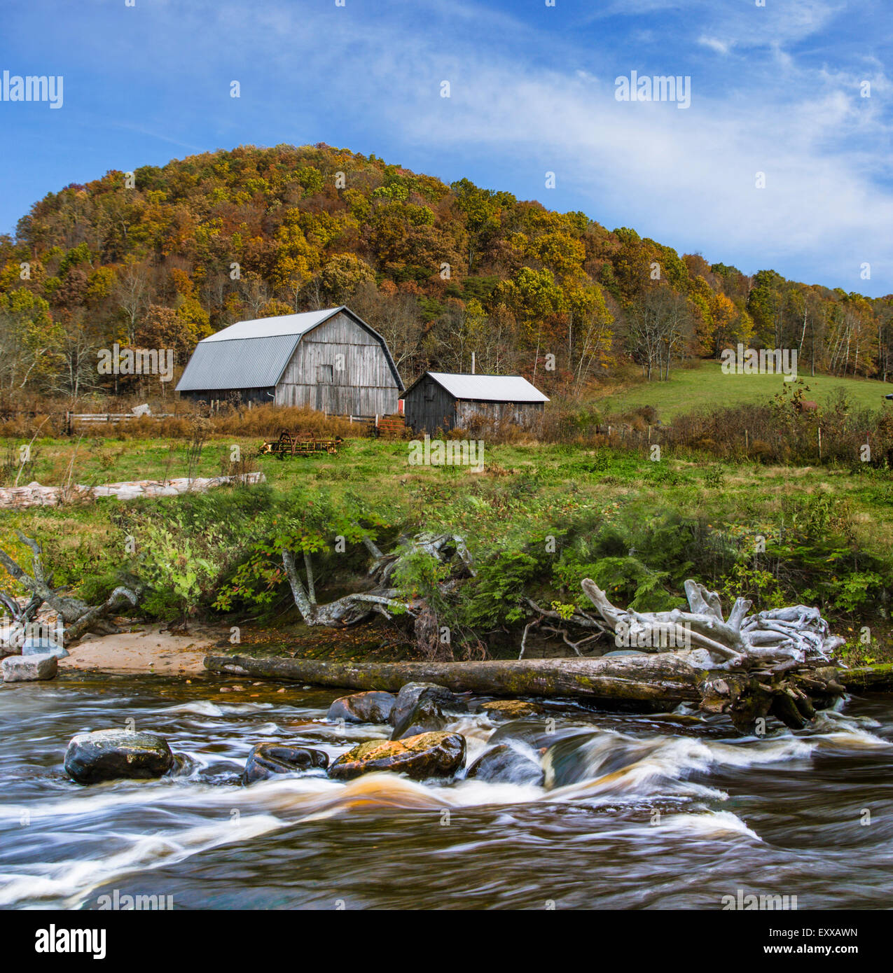 A Pastoral Landscape, Barn And River Below A Hill In Autumn, Central Ohio, USA - Stock Image