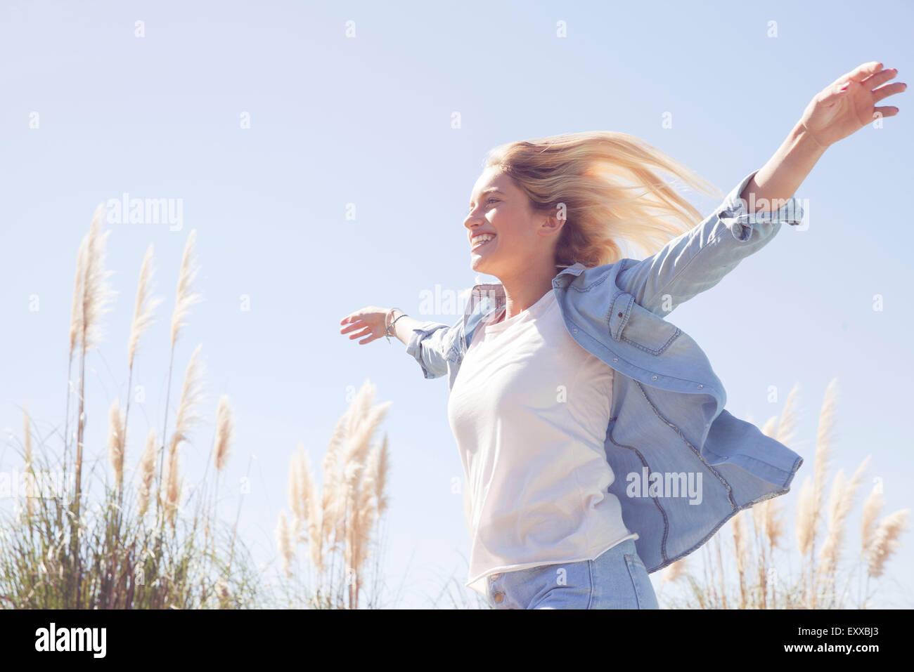 Woman enjoying fresh air outdoors - Stock Image