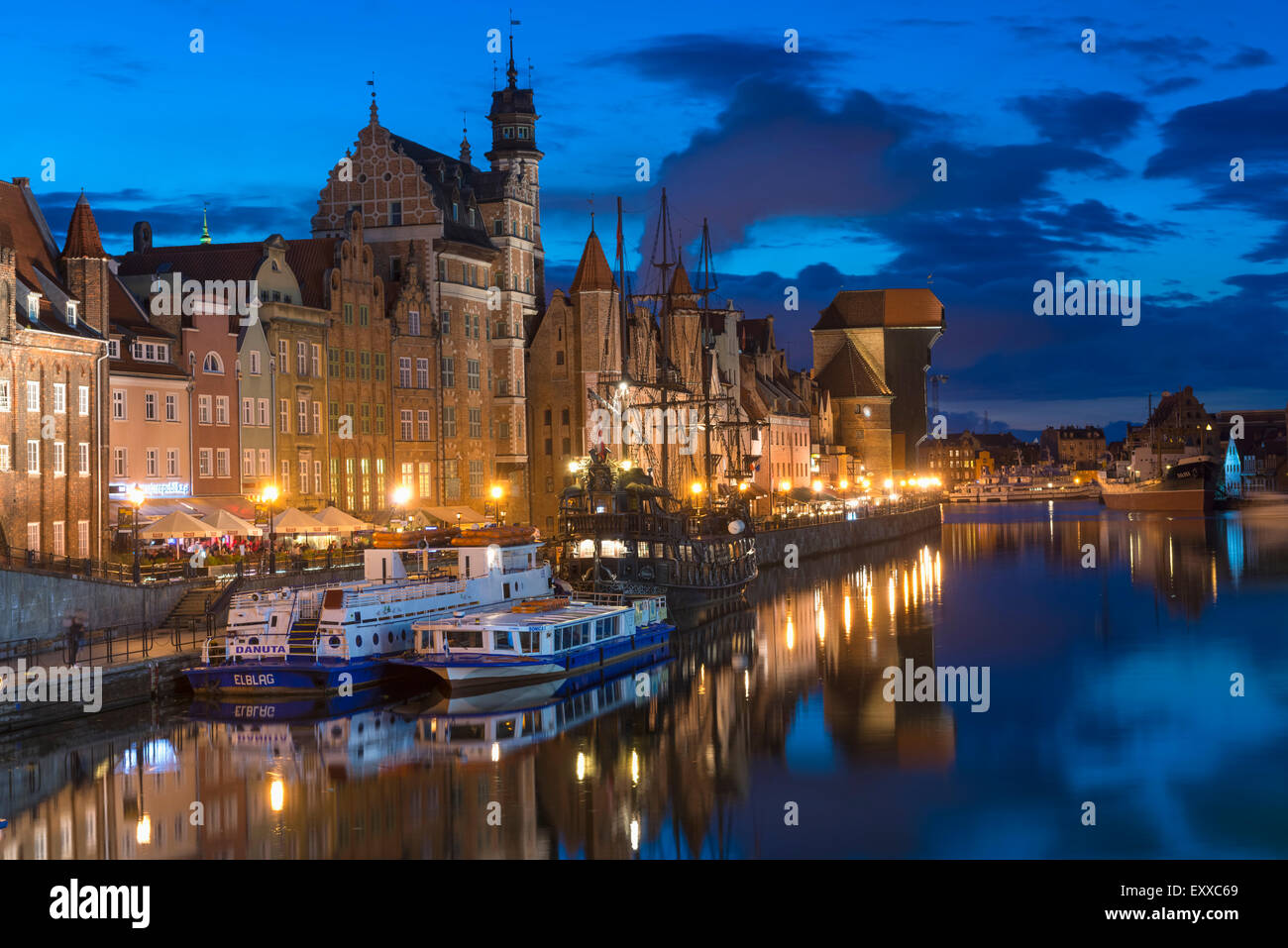 Gdansk, Poland - Beautiful, historic old town district of Gdansk, Poland on the banks of the River Motlawa at night - Stock Image