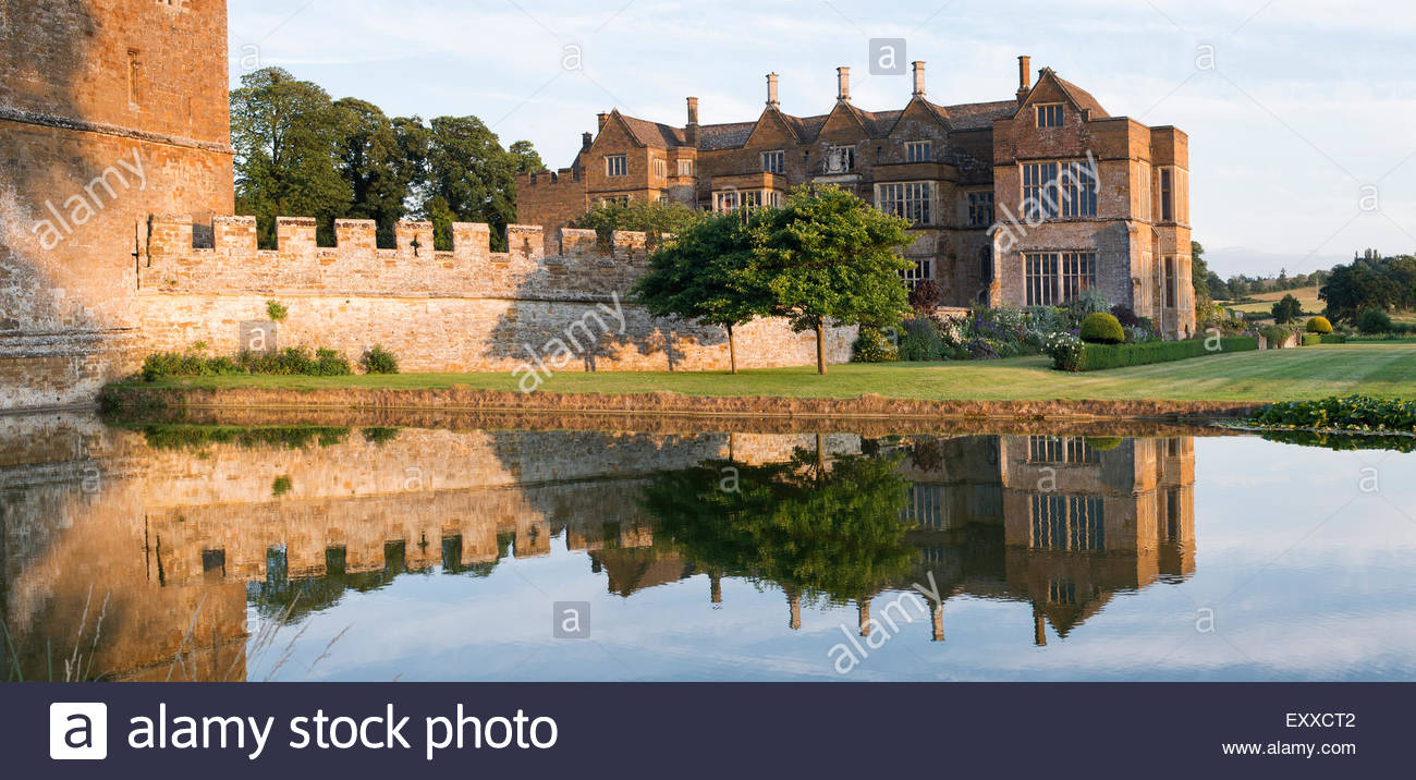 Broughton castle in the evening summer sunlight. Near Banbury, Oxfordshire, England. Panoramic - Stock Image