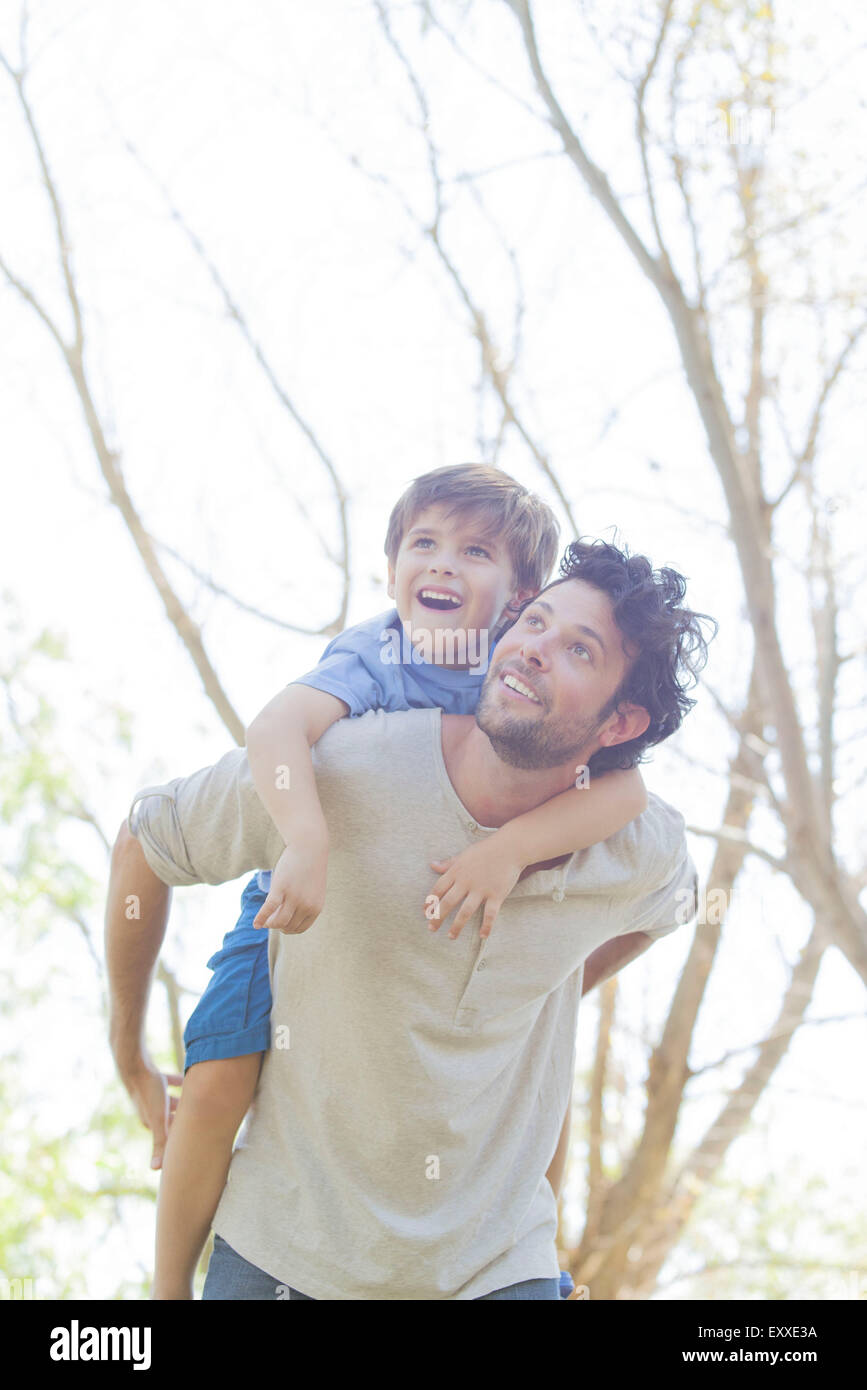 Father carrying young son piggyback Stock Photo