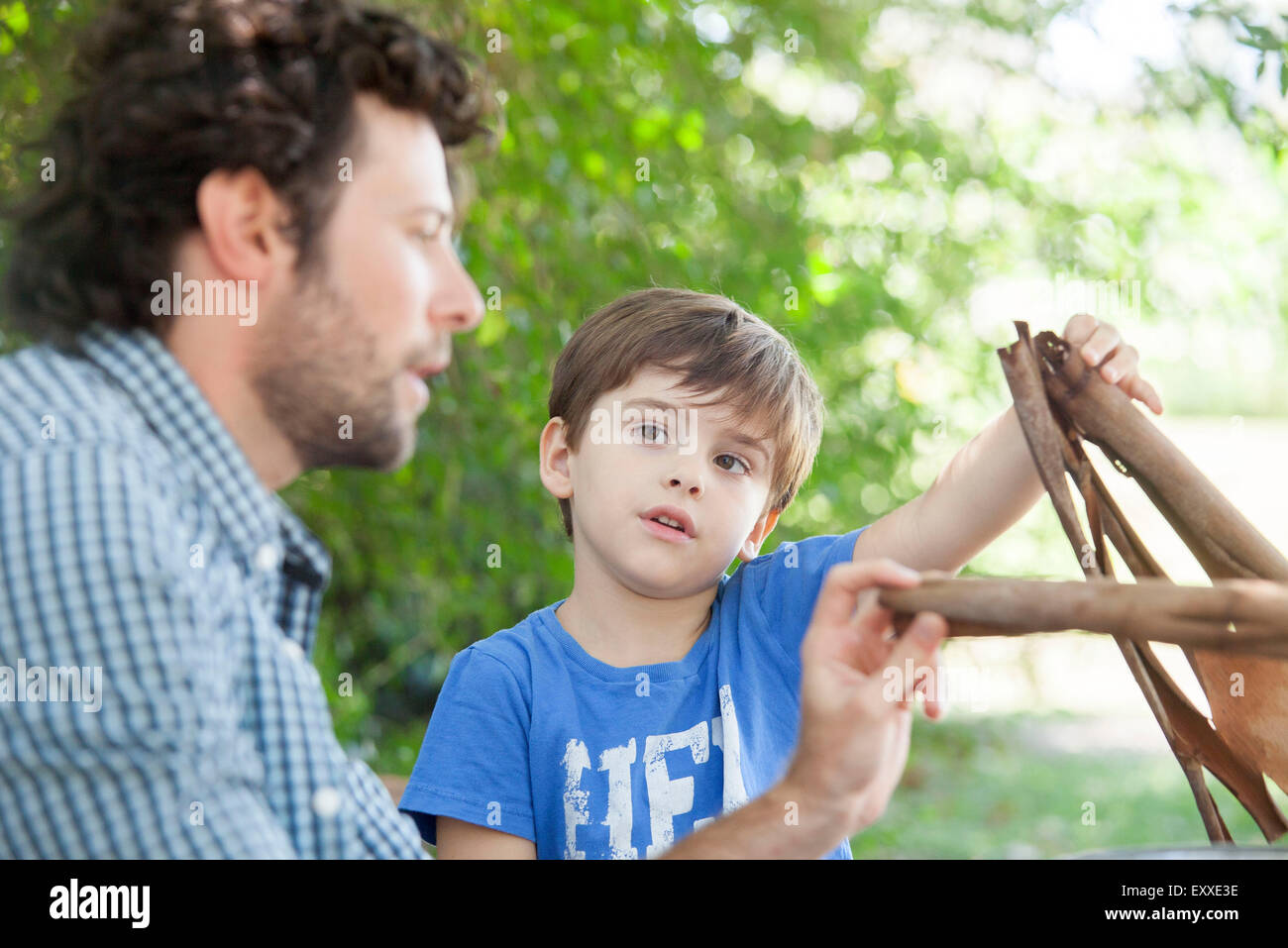 Father and son spending quality time together outdoors - Stock Image