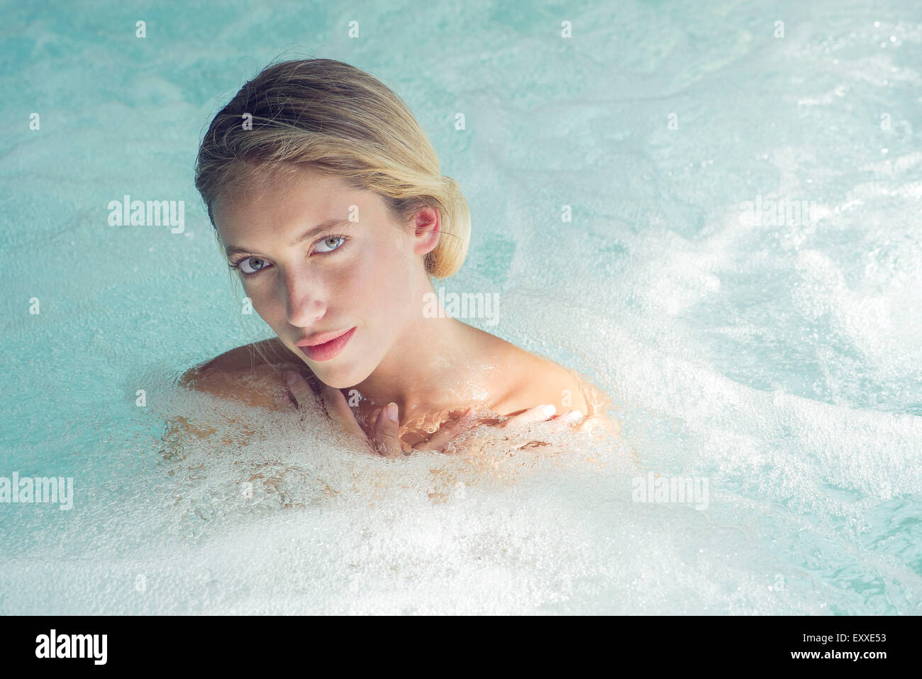 Woman soaking in spa pool - Stock Image