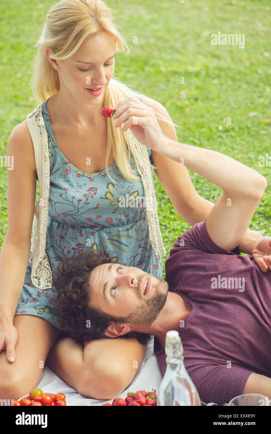 Couple having picnic together - Stock Image