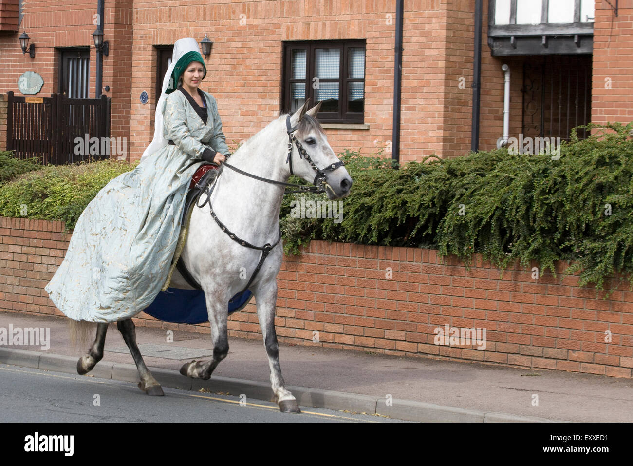 Horse And Rider In Medieval Costume Riding Though Tewkesbury Stock Photo Alamy
