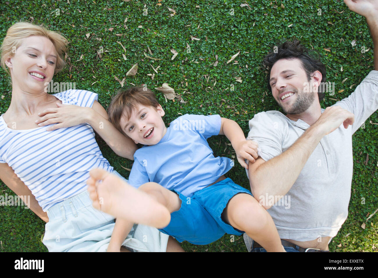 Young family enjoying carefree afternoon playing together - Stock Image