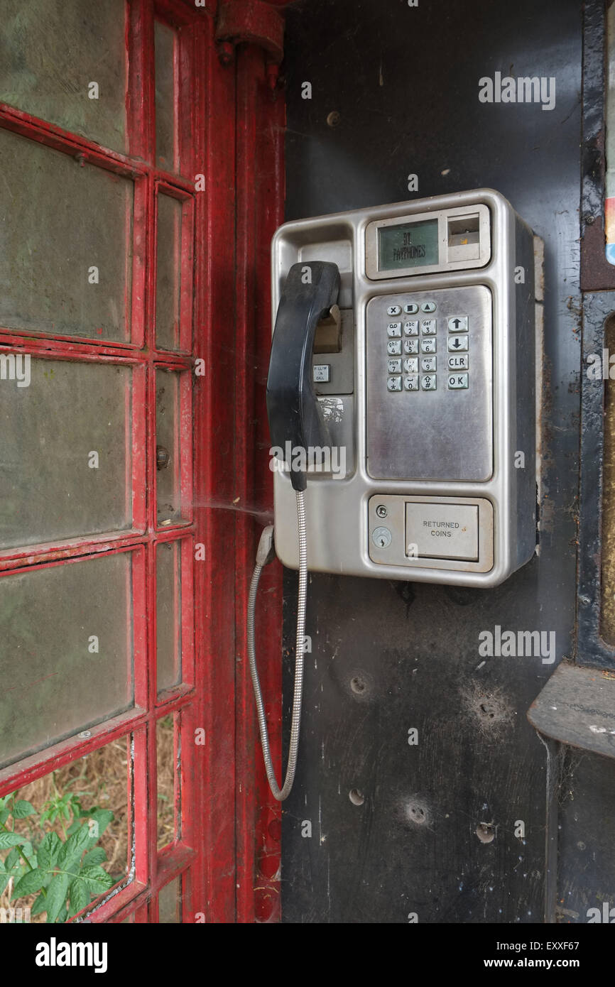 BT payphone in red telephone box. - Stock Image