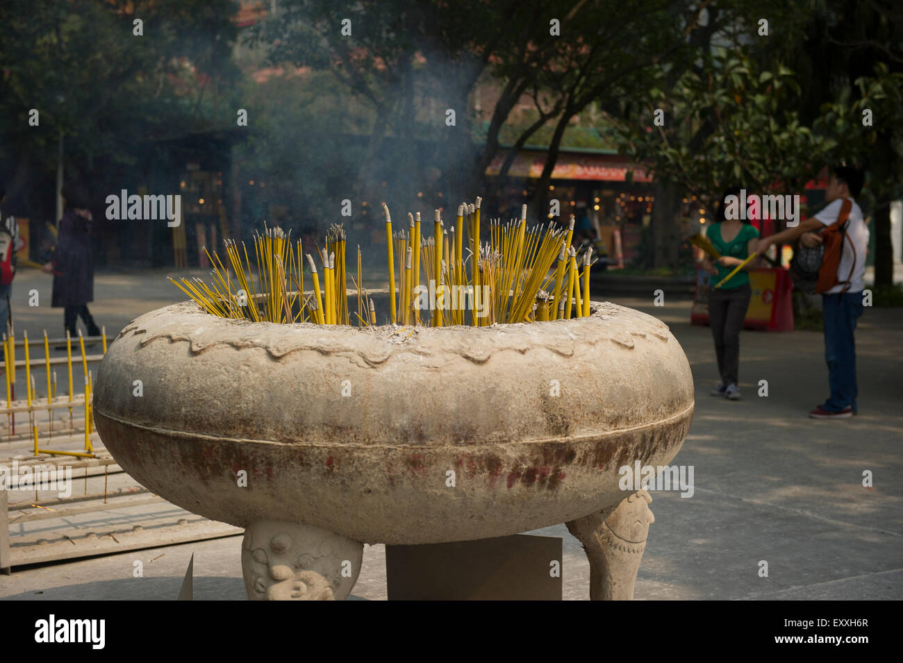 Buddhist ritual of Incense offerings placed in a censer at the entrance of Po LIn Monastery, Ngong Ping Plateau, - Stock Image