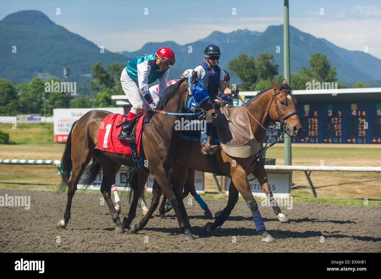 Post parade of jockey and horse race at Vancouver Hastings Exhibition Park race track. - Stock Image