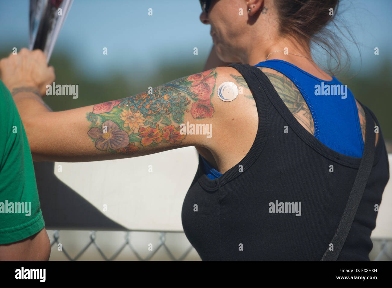 Woman with Tattoos on her arm Stock Photo  85406849 - Alamy 3e75a549ff7d