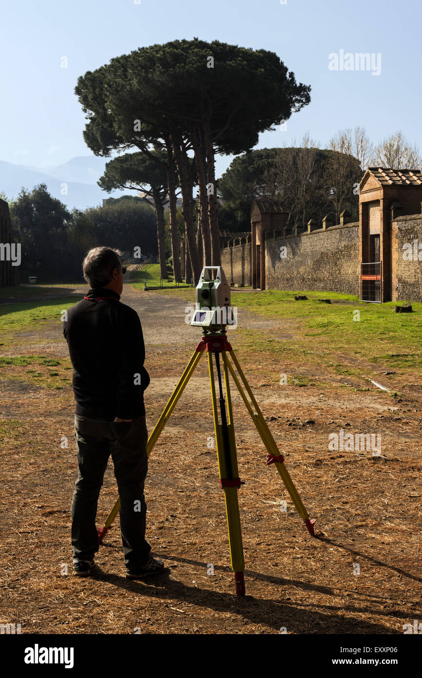 Surveyor at work at  Pompeii ruins in Italy - Stock Image