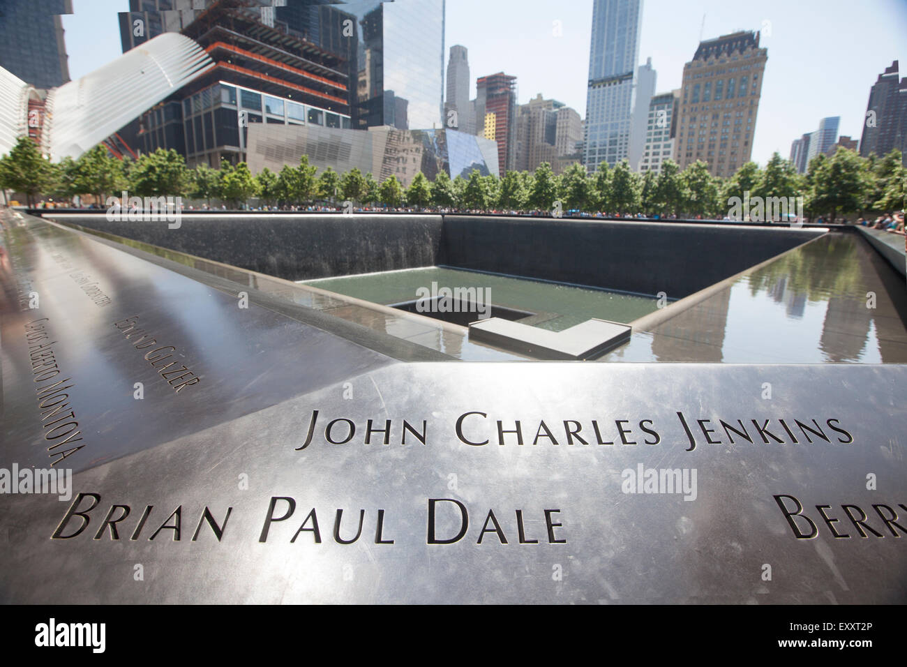 NEW YORK - May 30, 2015: Freedom Tower in Lower Manhattan and the Memorial. One World Trade Center is the tallest - Stock Image