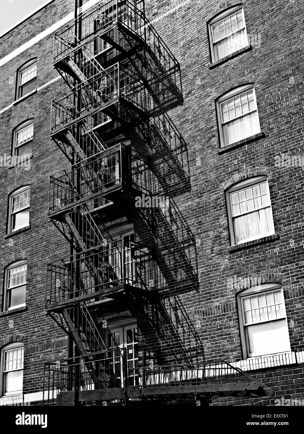 Fire Escape With Shadows On A Brick Apartment Building. Capitol Hill,  Seattle Washington