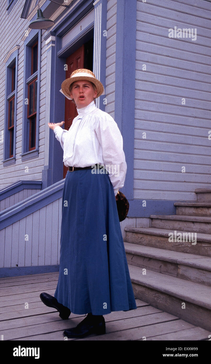 A costumed  role player gives a tour of the Dawson City Historical Complex,Yukon - Stock Image