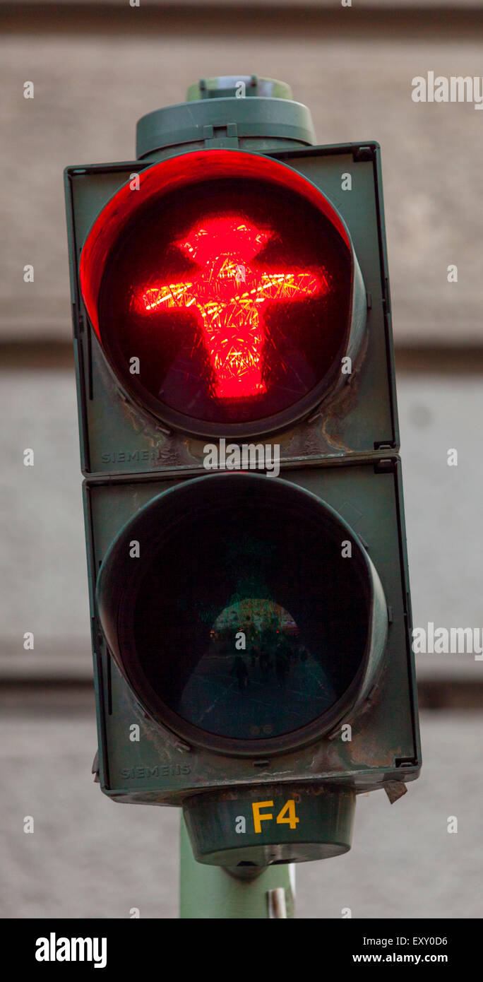 Ampelmannchen, the 'little traffic light man', pedestrian symbol in the former East Berlin. Red indicates - Stock Image