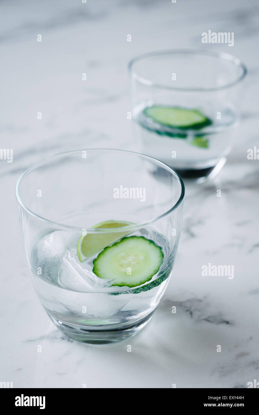 gin and tonic with lime and cucumber - Stock Image