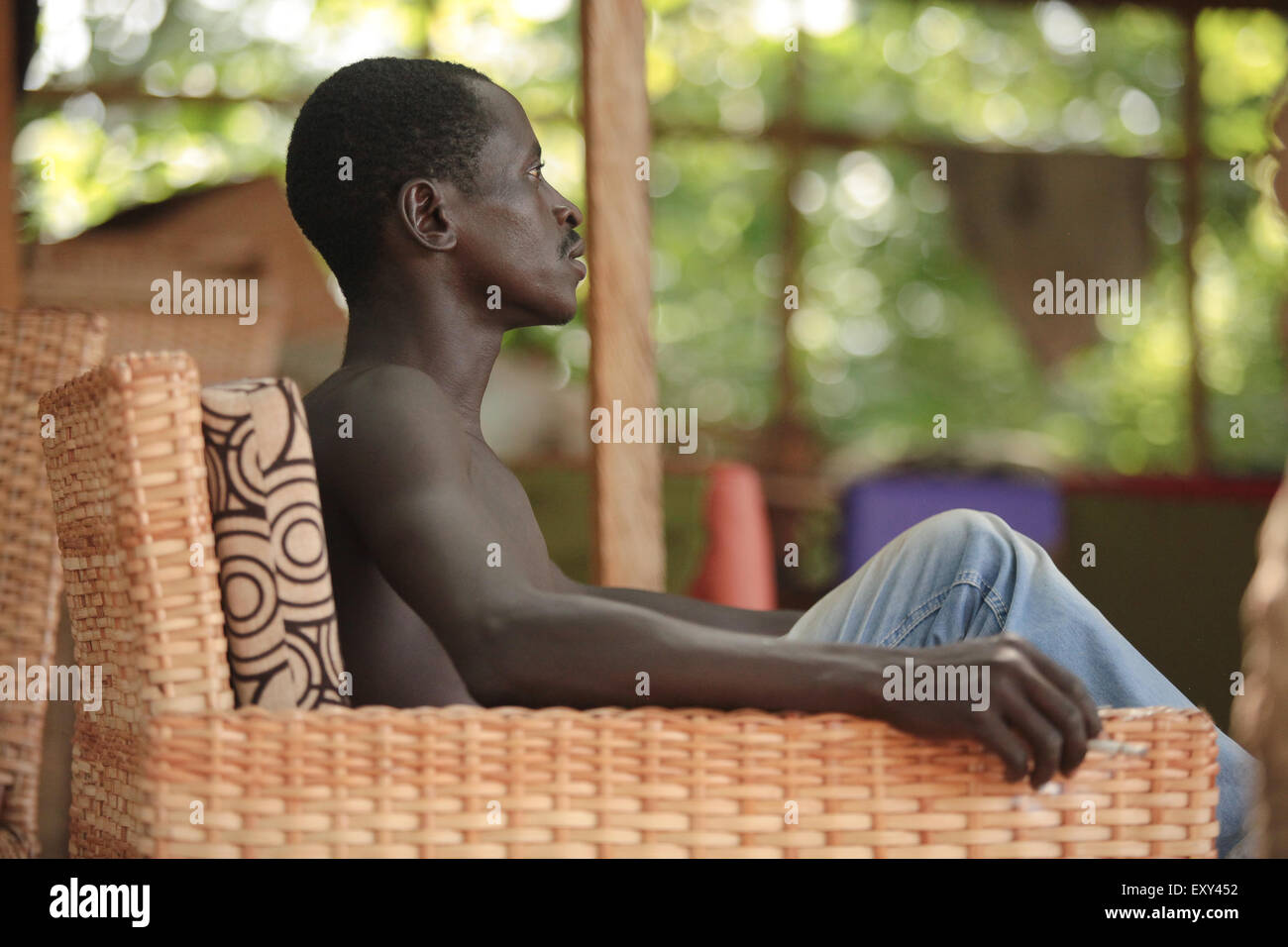 Abuja,6 November 2015. A young man using bamboo to design chair. Nigeria youth unemployment has always been a problem - Stock Image