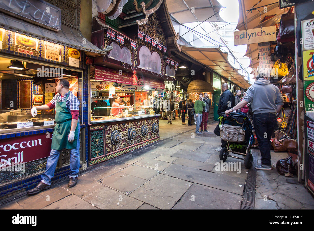 London, United Kingdom - October 10, 2014: View of The Stables at Camden Market in London with workers and visitors - Stock Image