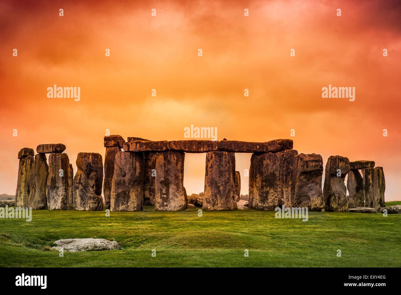 Stonehenge against fiery orange sunset sky Stock Photo