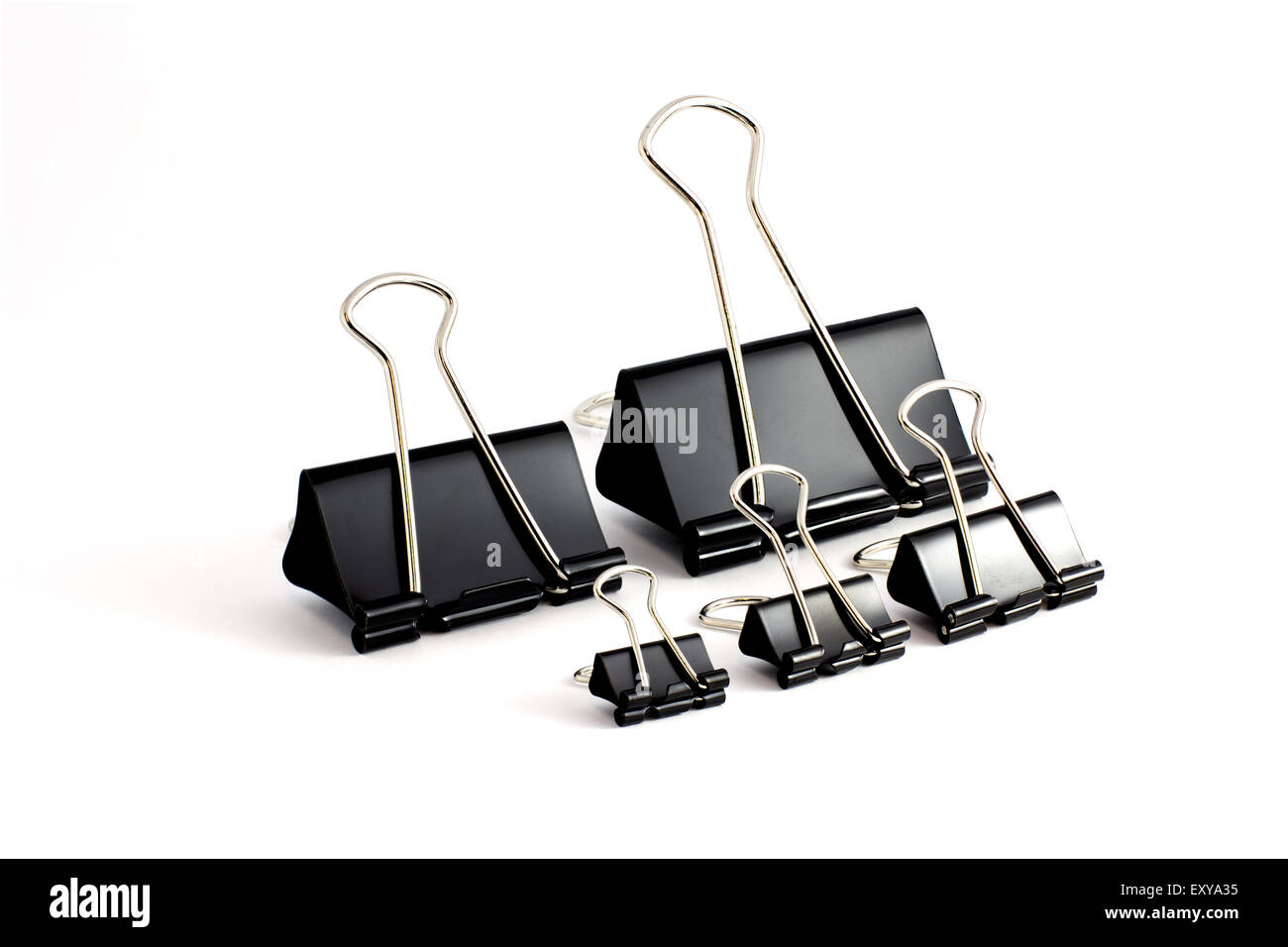 Different sizes of bulldog clips - Stock Image
