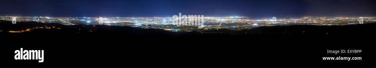 Panoramic view of city at night - Stock Image