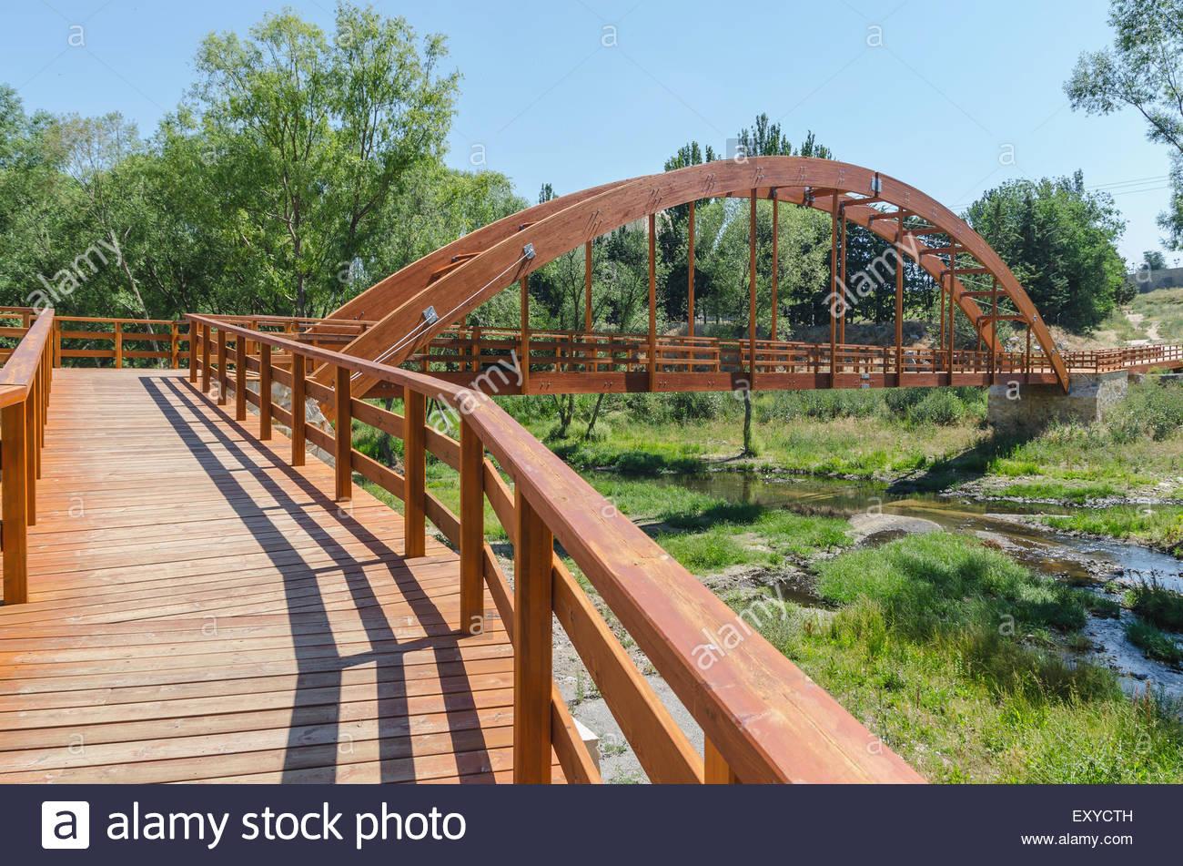 modern wooden bridge over river Adaja in the city of Avila, Spain - Stock Image