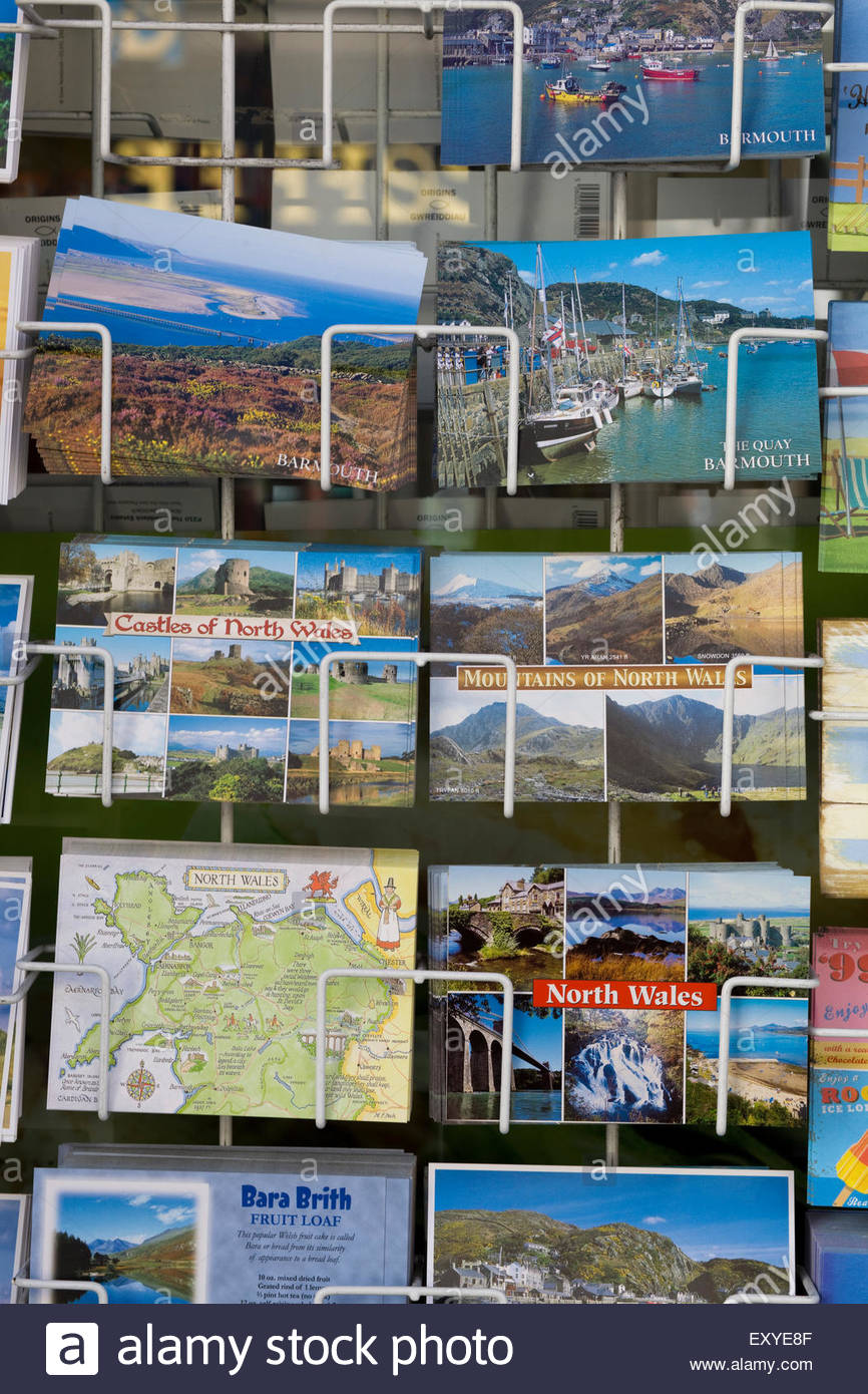 Traditional Seaside Postcards on sale in wales - Stock Image