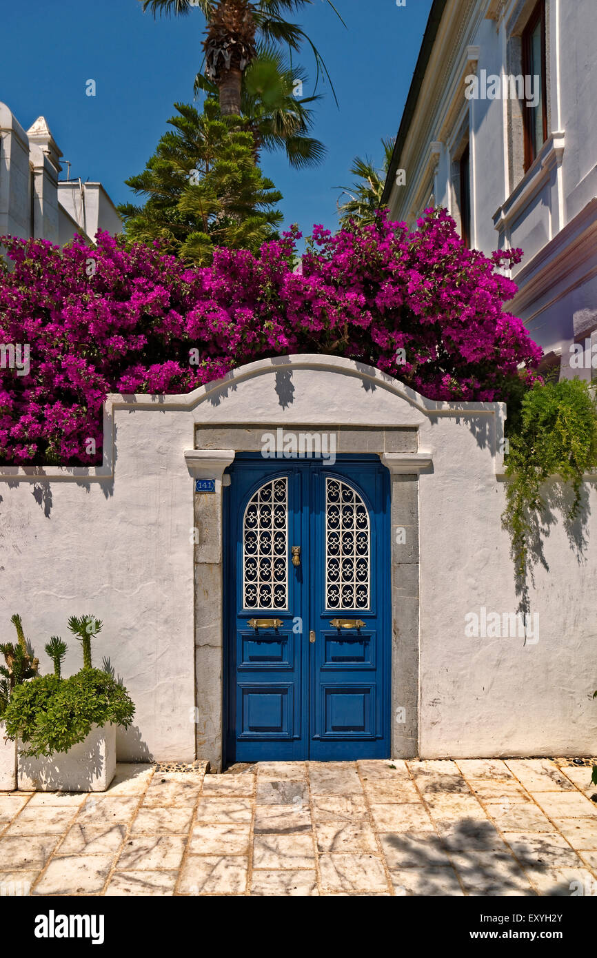 Greek or Turkish style doorway at Bodrum, Mugla Province, Turkey with Bougainvilleas. - Stock Image