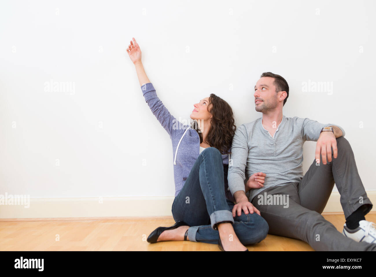 View of a Young couple in their brand new flat / Textspace - Stock Image