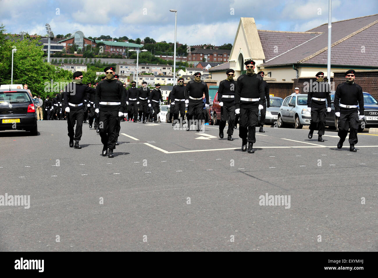 Londonderry, Northern Ireland, UK. 18 July, 2015. Funeral of prominent Irish Republican, Peggy O'Hara. Members of Stock Photo