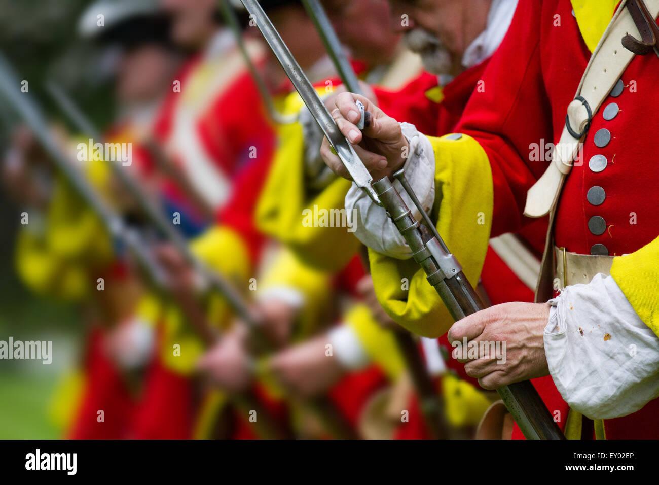 Hoghton, Preston, Lancashire, UK. 18th July, 2015.   Redcoats & musketeers, muskets firing guns gun soldiers soldiers, Stock Photo