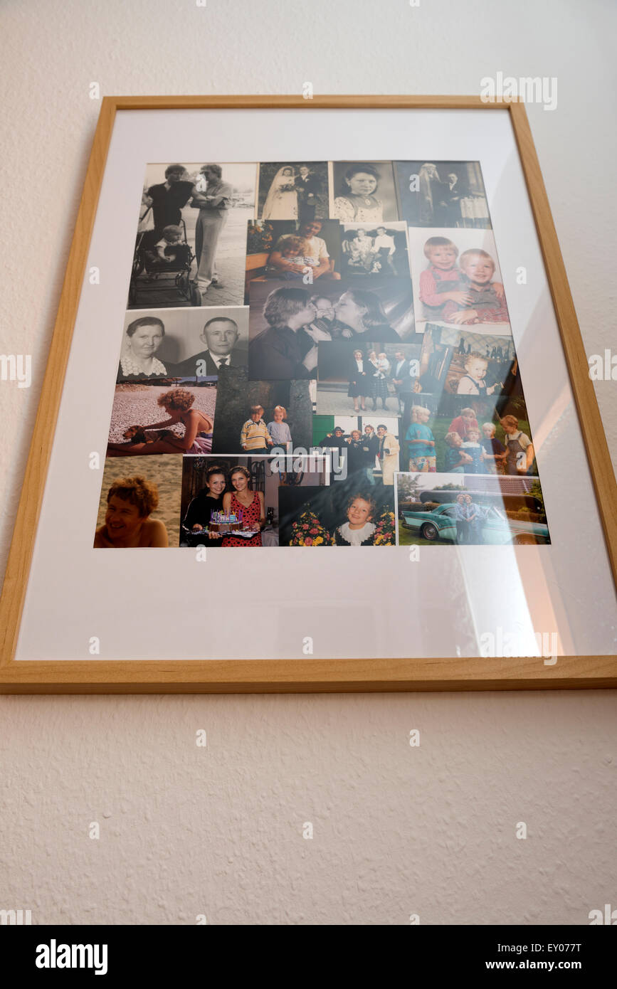 Multiple family photographs in one wall mounted frame - Stock Image