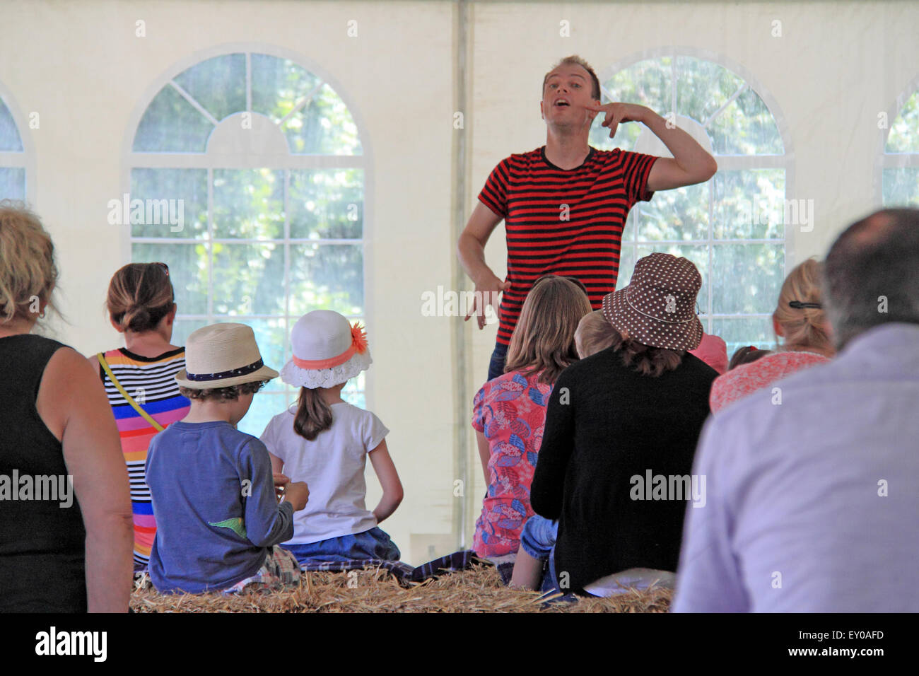 Dominic Berry performs his book 'The Dragon Who Hates Poetry' at Royal Horticultural Society Arts Fest, - Stock Image
