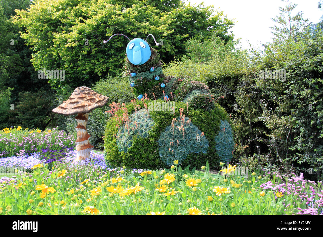 Caterpillar sculpture at Royal Horticultural Society Adventures in Wonderland, RHS Garden Wisley, Woking, Surrey, - Stock Image