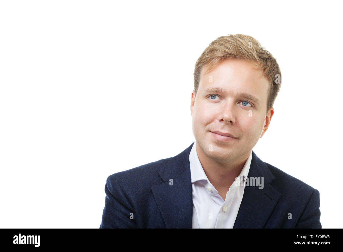 Portrait of a dreamy businessman on white background - Stock Image