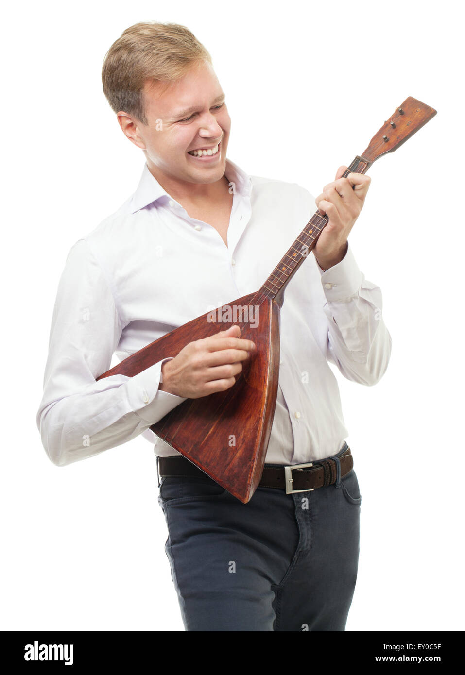 Excited young man playing balalaika, isolated on white - Stock Image