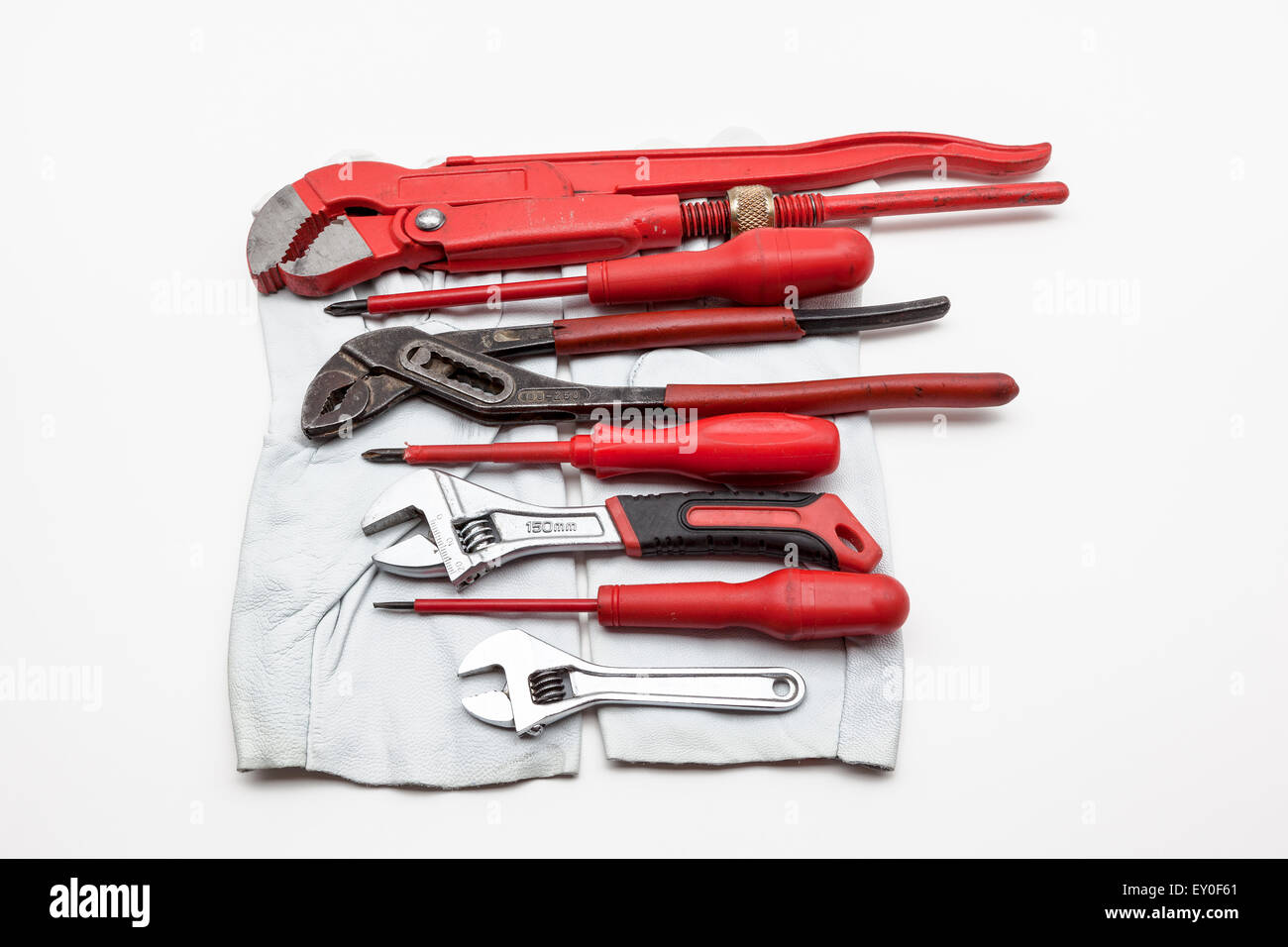 red wrench Isolated on white background whit work gloves Stock Photo