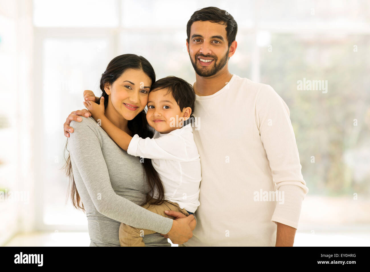 modern young Indian family portrait - Stock Image