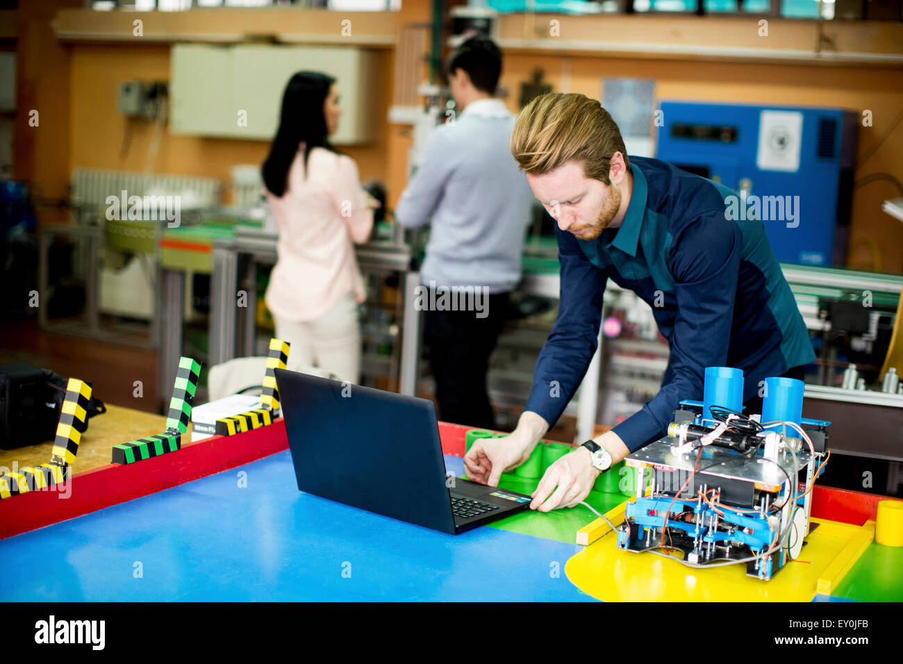 Young people in the robotics classroom - Stock Image