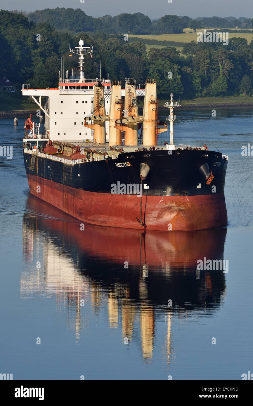 Supramax Bulkcarrier Hector reflecting in the calm water of Kiel Canal - Stock Image