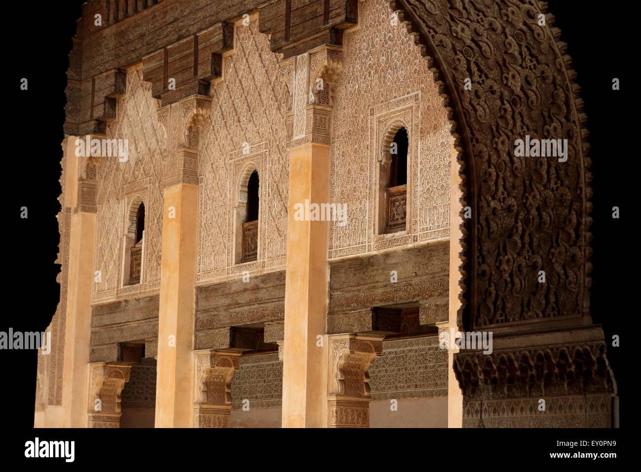 Richly detailed Arabesque stucco walls, at the Ben Youssef Madrasa, Marrakesh, Morocco - Stock Image