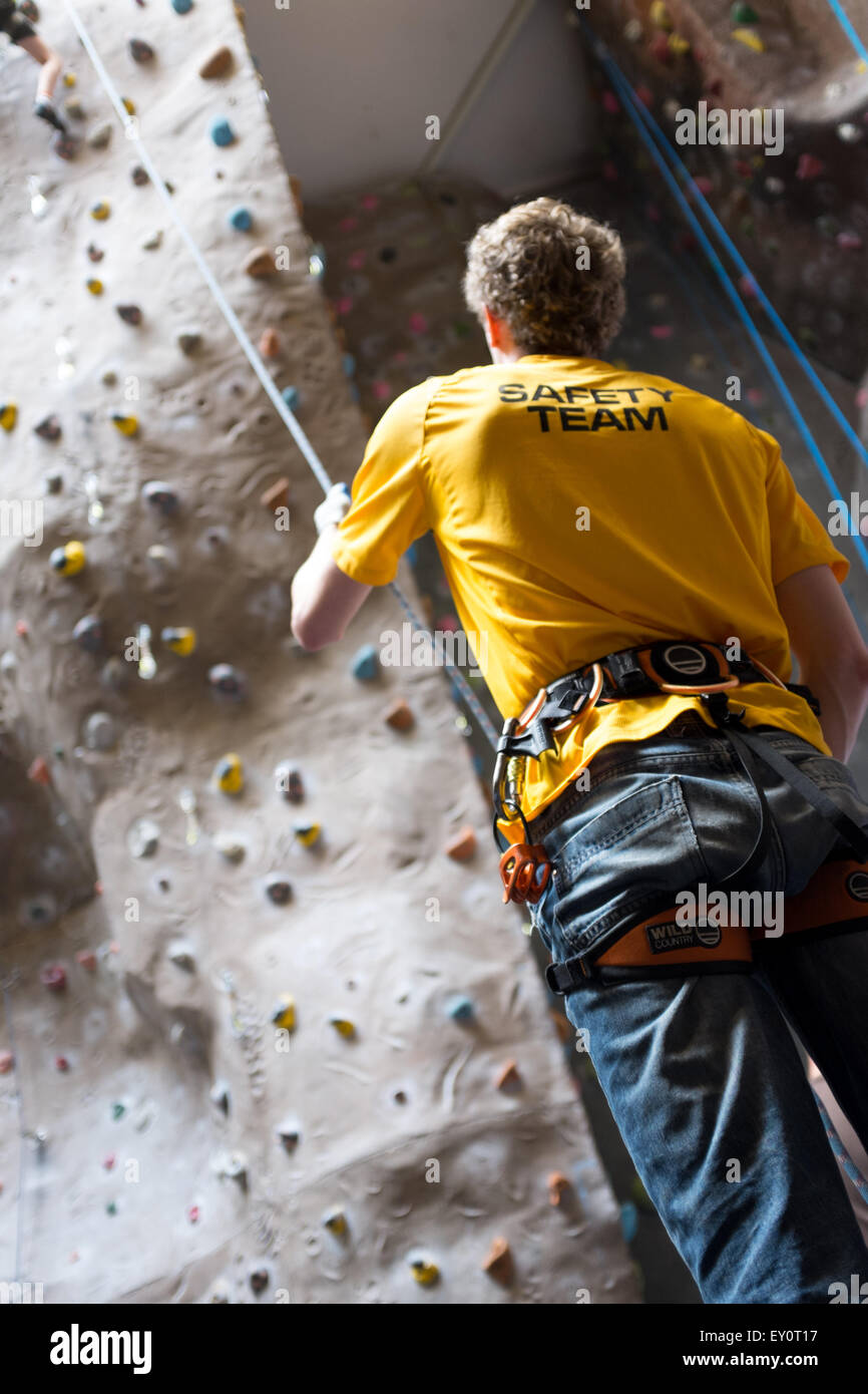 Instructor and climbers at an indoor climbing centre in the UK - Stock Image