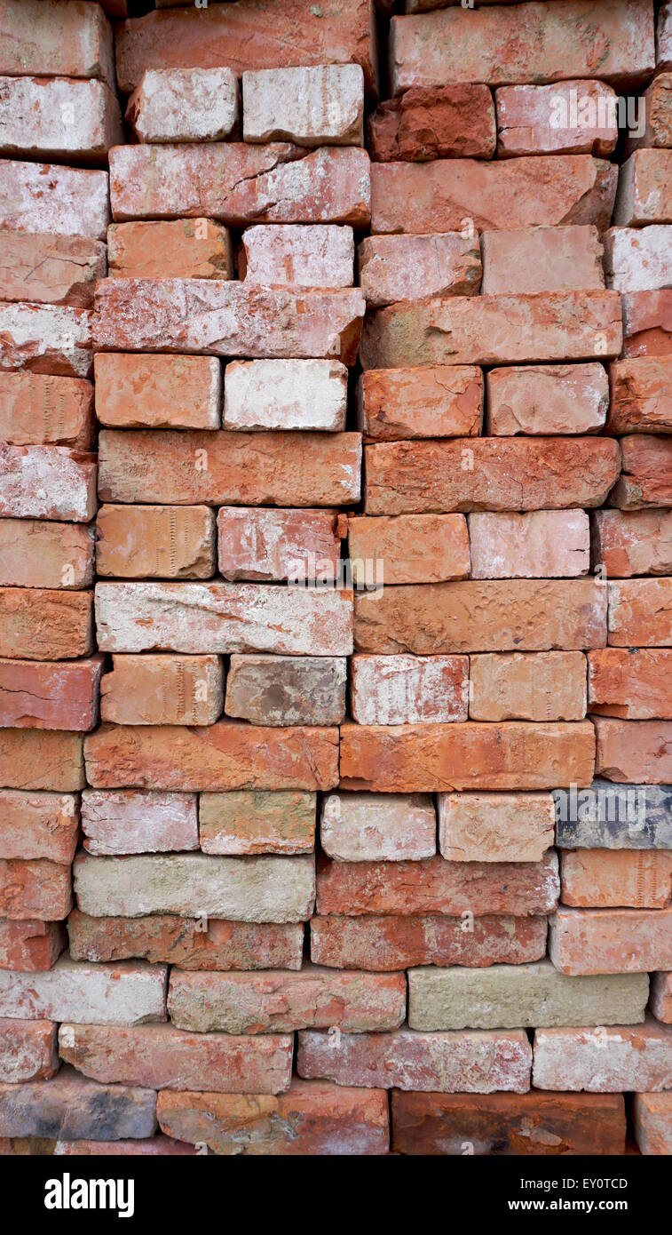 red bricks stacking for construction material texture background - Stock Image