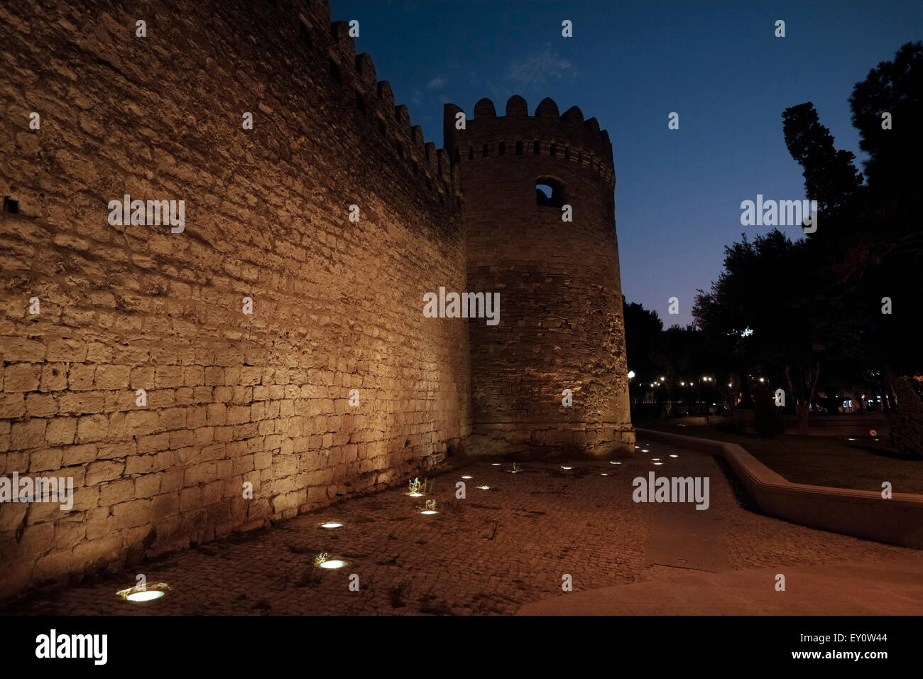 Ancient walls illuminated at night in Icheri Sheher which is the historical core of Baku listed in UNESCO World - Stock Image