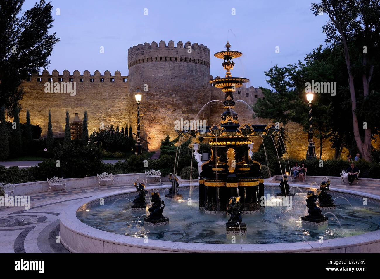 Old city walls illuminated at night in Icheri Sheher which is the historical core of Baku listed in UNESCO World - Stock Image