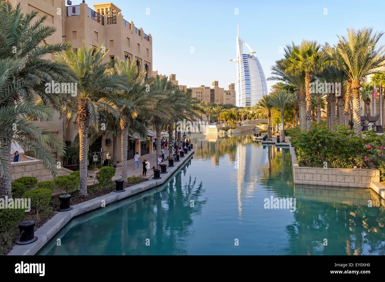 Dubai, UAE - January 08, 2012: View of Burj Al Arab from Madinat Jumeirah. Madinat is a luxurious resort in Dubai. - Stock Image