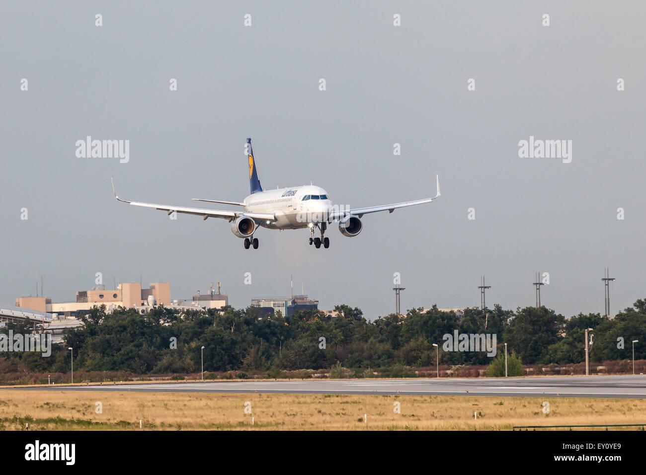 Lufthansa Airbus A320-200 aircraft landing at the Frankfurt International Airport. - Stock Image