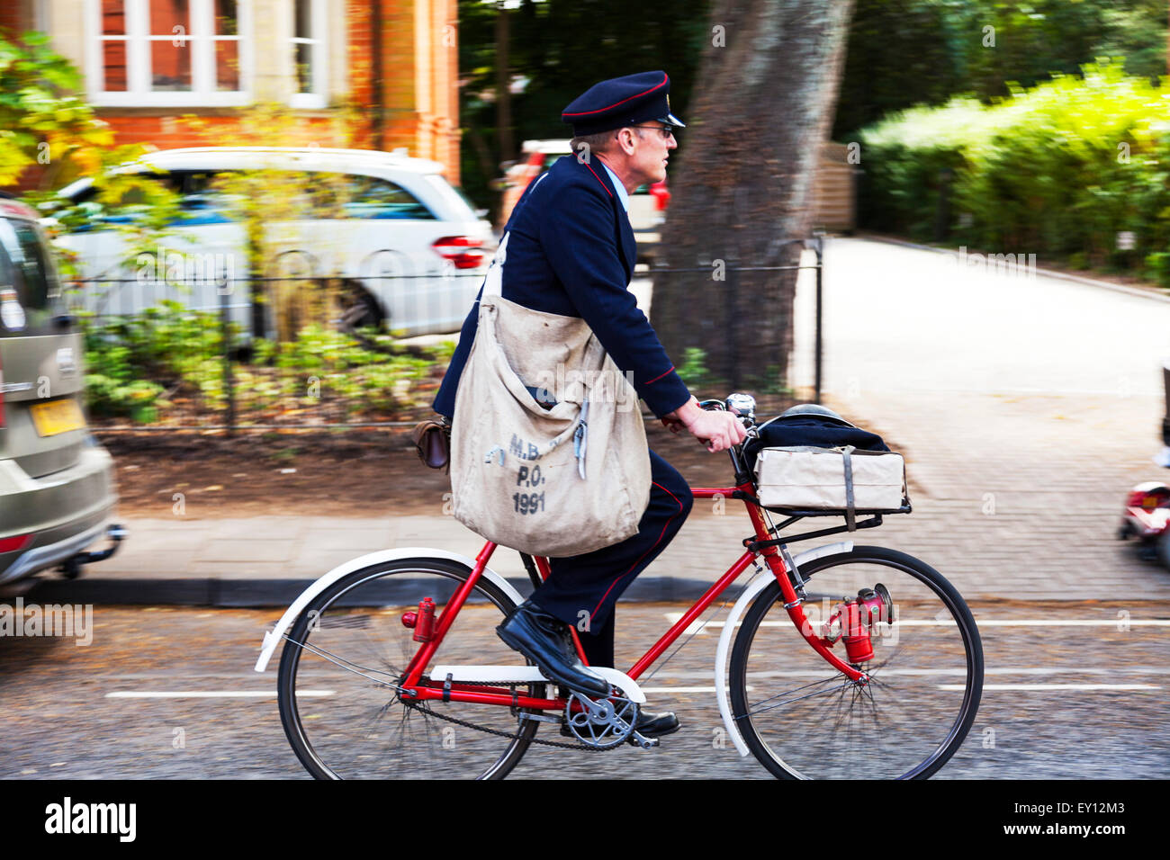 postman delivering letters on bike post 1940's bag cycle ...