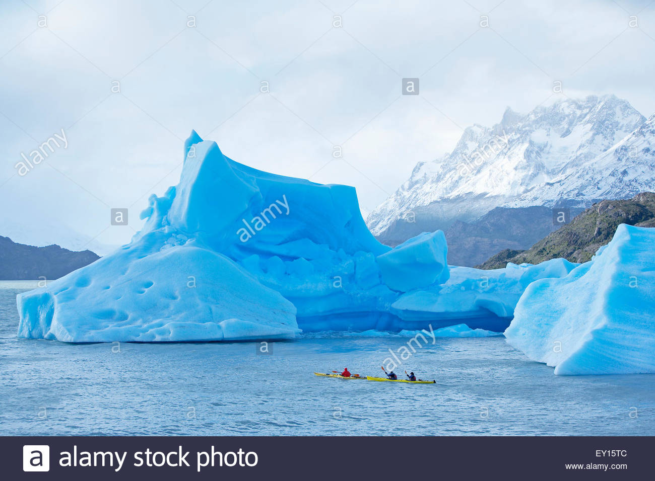 Kayakers navigating icebergs on lake, Torres del Paine National Park,Patagonian Andes, Patagonia, Chile, - Stock Image